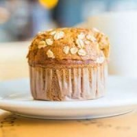 One perfect pumpkin lactation muffin sprinkled with oatmeal.