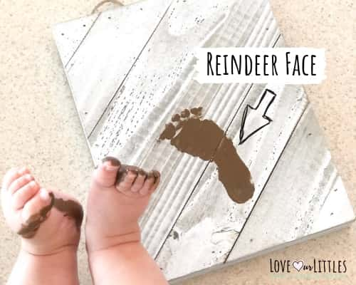 Baby feet with a baby footprint on canvas