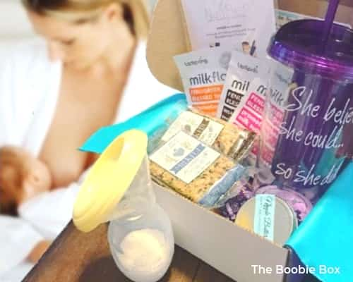 Photo of mom breastfeeding with the Boobie Box full of breastfeeding products.
