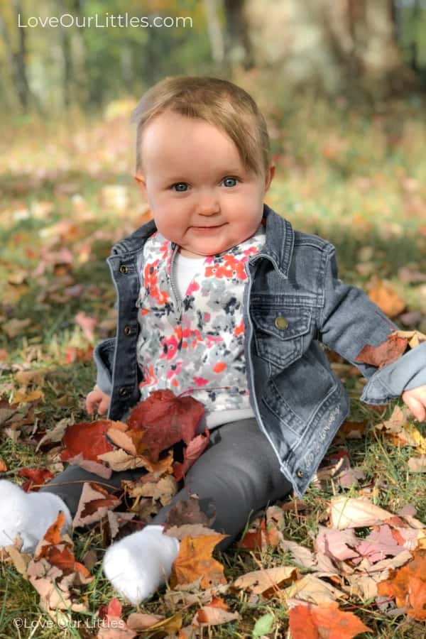 Baby in a pile of leaves for her first fall picture ideas