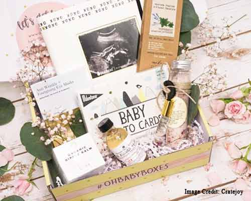 Overflowing subscription box for a new mom with postpartum products.