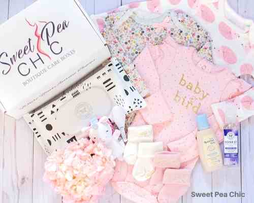 Sweet Pea Chic baby subscription box full of newborn clothes and essentials.