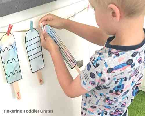 Toddler creating new things with a tinkering toddler crate subscription box