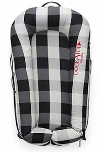 DockATot with black and white plaid cover.