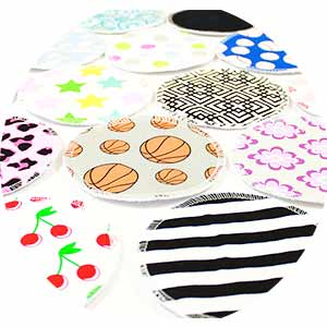 Multi-colored and patterned fabric breast pads for nursing.