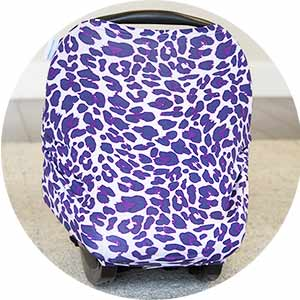Photo of a carseat with a purple leopard print jersey carseat canopy over it.
