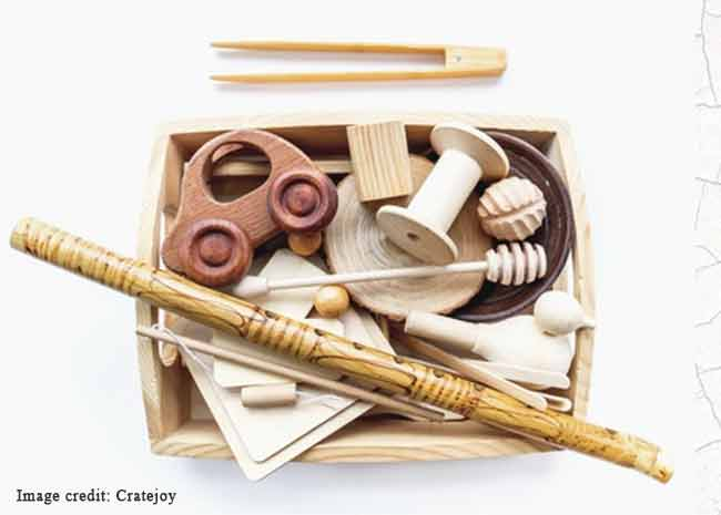 Subscription box full of wooden Montessori toys for toddlers.