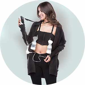 Woman pumping with the BabyBuddha breast pump.