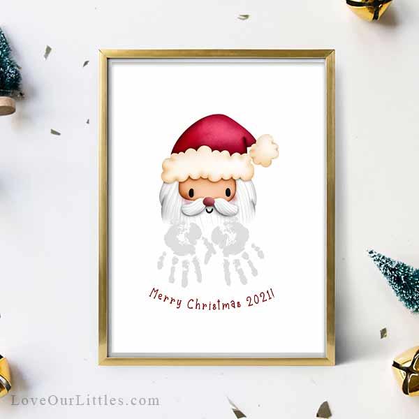Mockup of a Santa face with handprint beard that says Merry Christmas 2021