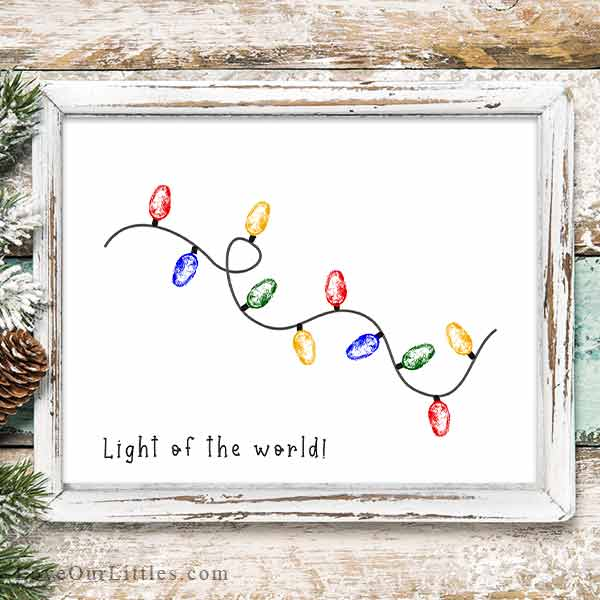 Mockup of a thumbprint Christmas craft with a string of Christmas lights in red, yellow, green and blue.