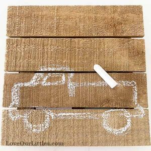Vintage truck sketched on to wood sign with chalk.