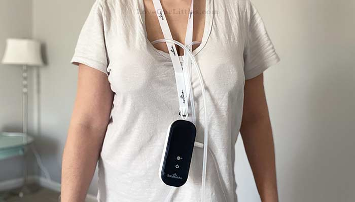 Woman wearing the BabyBuddha breast pump with her Spectra handsfree cups.