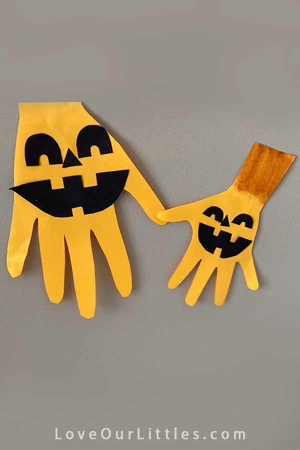 Pumpkin handprint crafts for toddlers.